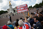 On the first day of the state visit by US President Donald Trump people come to see his arrival at Buckingham Palace including these Trump supporters on 3rd June 2019 in London, United Kingdom.