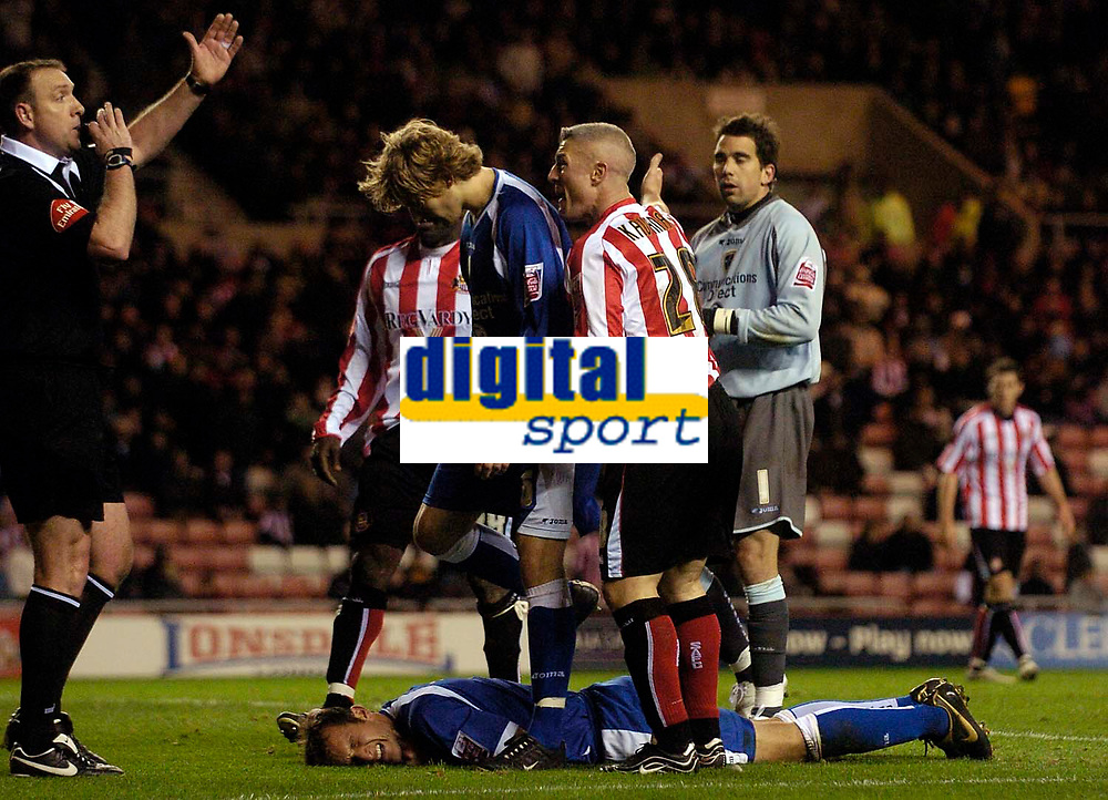 Photo: Jed Wee.<br /> Sunderland v Cardiff City. Coca Cola Championship. 31/10/2006.<br /> <br /> Cardiff's Riccardo Scimeca lies on the ground injured as Sunderland's Graham Kavanagh protests what his team sees as deliberate time wasting.