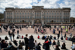 © Licensed to London News Pictures.09/04/2021. London, UK. Members of the public gather in front of Buckingham Palace following an announcement regarding the death of Prince Philip. Buckingham Palace has announced that Prince Philip The Duke of Edinburgh passed away this morning at Windsor Castle . Photo credit: George Cracknell Wright/LNP