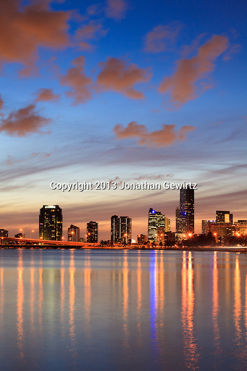 The William Powell Bridge and Rickenbacker Causeway at dusk with condo buildings on Miami's Brickell Avenue in the background. WATERMARKS WILL NOT APPEAR ON PRINTS OR LICENSED IMAGES.