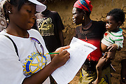A health worker fills a form to track the number of children vaccinated during a national polio immunization exercise in the village of Gidan-Turu, northern Ghana on Thursday March 26, 2009.
