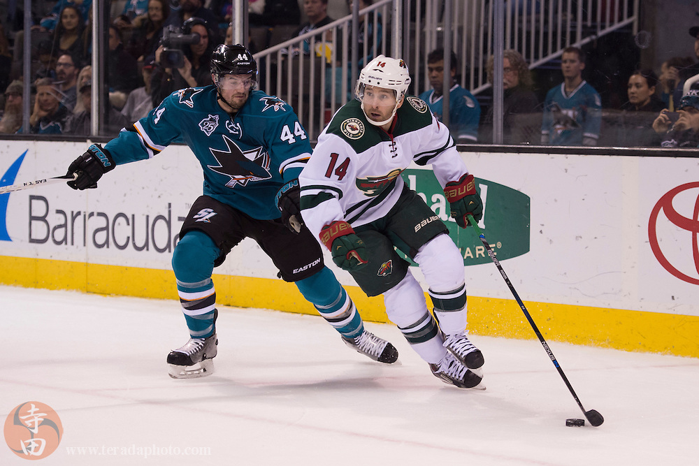 December 12, 2015; San Jose, CA, USA; Minnesota Wild right wing Justin Fontaine (14) controls the puck defended by San Jose Sharks defenseman Marc-Edouard Vlasic (44) during the first period at SAP Center at San Jose. The Wild defeated the Sharks 2-0.