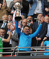 Football - 2019 Buildbase FA Trophy Final - AFC Fylde vs. Leyton Orient<br /> <br /> Fylde Manager, Dave Challinor with the trophy at the top of the Wembley steps, at Wembley Stadium.<br /> <br /> COLORSPORT/ANDREW COWIE