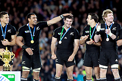 © Andrew Fosker / Seconds Left Images 2011 - New Zealand's Jerome Kaino (2nd left)  pats New Zealand's Stephen Donald (Centre) on the head as they wait for the trophy presentation  -  France v New Zealand - Rugby World Cup 2011 - Final - Eden Park - Auckland - New Zealand - 23/10/2011 -  All rights reserved..