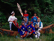 The St. Elias Dancers of the Tlingit village of Yakutat.  Elders: Edith Rener, Oscar Frank, Sr. and Susie Abraham in carved cedar canoe, Fourth of July, 1991, Yakutat, Alaska.  (Please note:  Licensing of this photograph requires a small extra fee be paid that goes to help support the St. Elias Dancers.  Contact Fred Hirschmann for information - 907-745-6616)