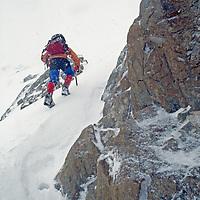 A mountaineer climbs through a storm in a previously unexplored Chilean range.