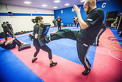 Students kicking pads as Stef Noij, KMG Instructor from the Institute Krav Maga Netherlands, takes the IKMS G Level Programme seminar today at the Scottish Martial Arts Centre, Alloa.