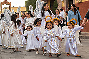Young girls dressed as angels walk in a procession from the Parroquia de San Miguel Arcangel church at the start of the week long fiesta of the patron saint Saint Michael  September 21, 2017 in San Miguel de Allende, Mexico.