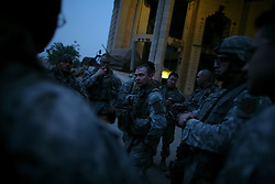 Soldiers with Charlie Co. 1-26 Infantry 1st Infantry Division prepare to depart for a mission to guard engineers raising a wall, amongst much controversy, around the beleaguered Baghdad Sunni district of Adhamiya on Sunday April 28, 2007.
