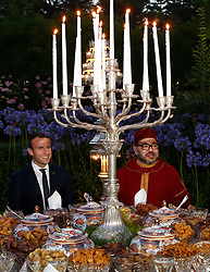 In this photo dated Wednesday, June 14, 2017 Morocco's King Mohammed VI, right, and French President Emmanuel Macron, attend an Iftar meal, the evening meal when Muslims end their daily Ramadan fast at sunset, at the King Palace in Rabat, Morocco. The visit is the first by the recently elected French president to a North African country and aims to strengthen the relationship between France and Morocco, including cooperation on security issues. Photo by Abdeljalil Bounhar/Pool/ABACAPRESS.COM