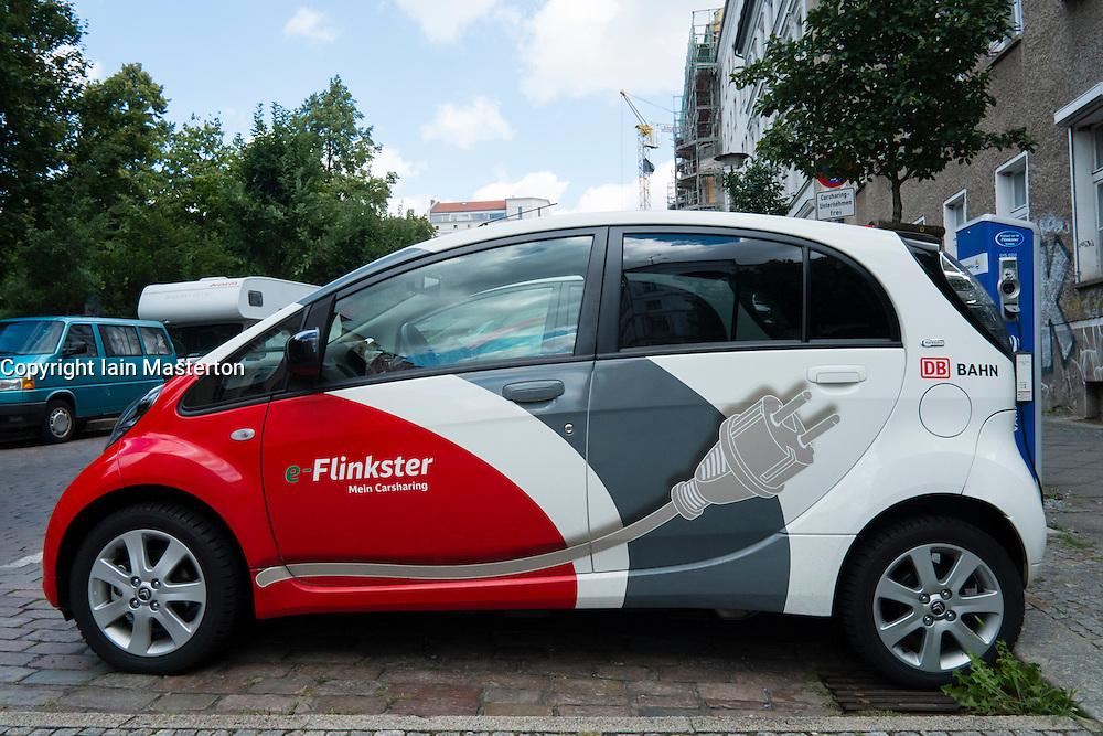 electric Flinkster car sharing car charging on Berlin street Germany