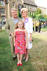 Left to right, PAUL & LYNN NARRAWAY she is MD of Hollan America Cruises sponsors of the party and their daughter SASHA NARRAWAY at the Lord's Taverners Diamond Jubilee Garden Party held in College Gardens, Westminster Abbey, London on 8th July 2010.
