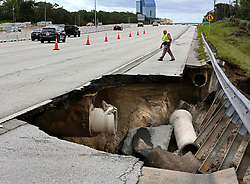 September 11, 2017 - Longwood, Florida, U.S. - A Florida Highway Patrol trooper inspects a closed segment of Interstate 4, near State Road 434, after a portion of the interstate highway northeast of Orlando washed away during Hurricane Irma's passing through central Florida on Sunday night. (Credit Image: © Joe Burbank/TNS via ZUMA Wire)