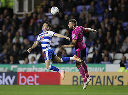 Reading's Liam Kelly (left) and Queens Park Rangers's Angel Rangel battle for the ball during the Sky Bet Championship match between Reading and Queens Park Rangers.