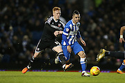 Brighton central midfielder, Beram Kayal (7) gets away from Brentford midfielder Ryan Woods during the Sky Bet Championship match between Brighton and Hove Albion and Brentford at the American Express Community Stadium, Brighton and Hove, England on 5 February 2016.