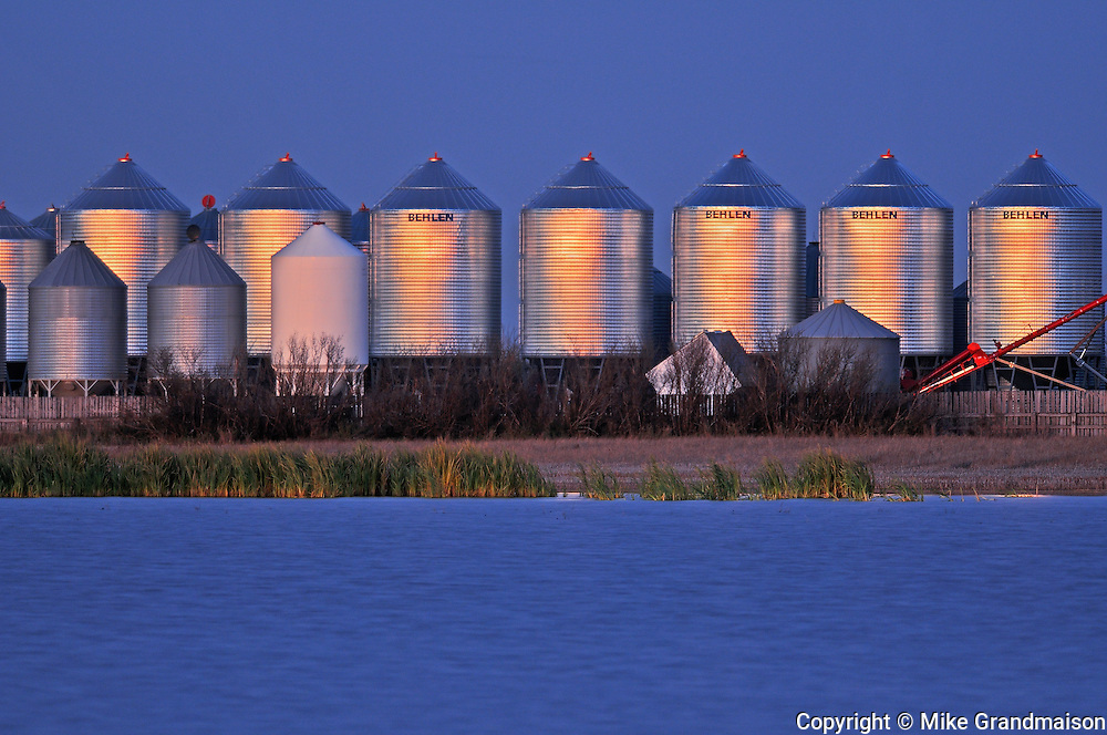 Grain bins at dusk<br /> Tuxford<br /> Saskatchewan<br /> Canada