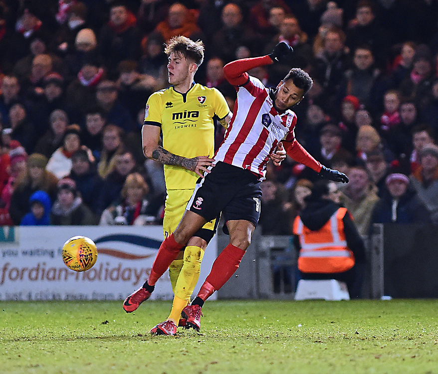 Lincoln City's Matt Green vies for possession with Cheltenham Town's Joe Rodon<br /> <br /> Photographer Andrew Vaughan/CameraSport<br /> <br /> The EFL Sky Bet League Two - Lincoln City v Cheltenham Town - Tuesday 13th February 2018 - Sincil Bank - Lincoln<br /> <br /> World Copyright © 2018 CameraSport. All rights reserved. 43 Linden Ave. Countesthorpe. Leicester. England. LE8 5PG - Tel: +44 (0) 116 277 4147 - admin@camerasport.com - www.camerasport.com