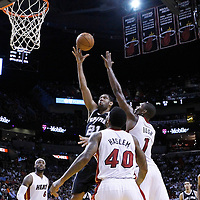 17 January 2012: San Antonio Spurs center Tim Duncan (21) goes for the layup over Miami Heat power forward Chris Bosh (1) during the Miami Heat 120-98 victory over the San Antonio Spurs at the AmericanAirlines Arena, Miami, Florida, USA.