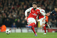 Olivier Giroud of Arsenal scores his sides 1st goal from a penalty to equalise at 1-1. UEFA Champions league group A match, Arsenal v Paris Saint Germain at the Emirates Stadium in London on Wednesday 23rd November 2016.<br /> pic by John Patrick Fletcher, Andrew Orchard sports photography.
