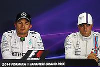 (L to R): Nico Rosberg (GER) Mercedes AMG F1 and Valtteri Bottas (FIN) Williams in the FIA Press Conference.<br /> Japanese Grand Prix, Saturday 4th October 2014. Suzuka, Japan.