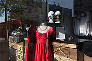 As the country continues the UK governments Coronavirus lockdown with social distancing rules still in effect, a mannequin and face masks are seen in the window of a closed Dry Cleaners business in Lordship Lane in East Dulwich, south London, on 18th May 2020, in London, England.