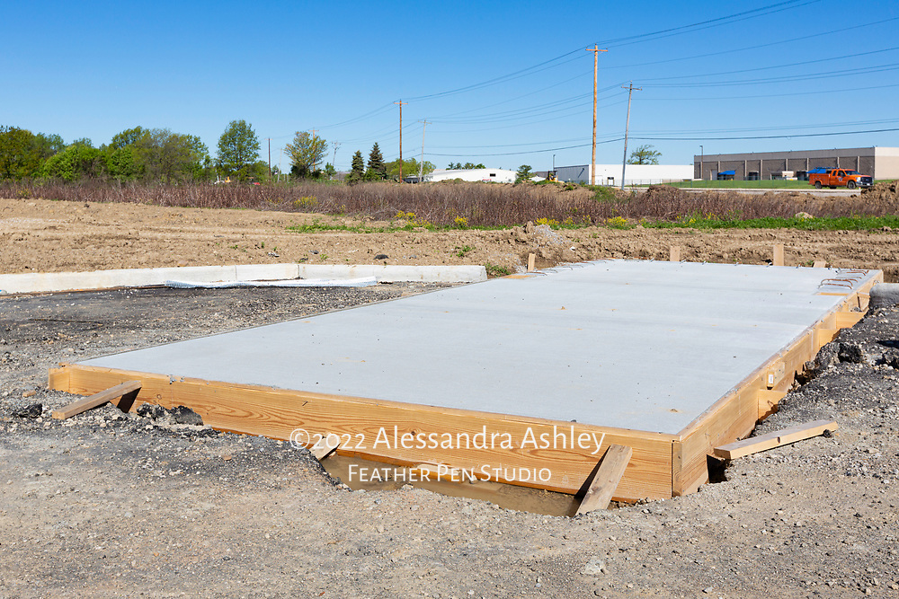 Completed cement pad for dumpster at site of new physical therapy and wellness center.