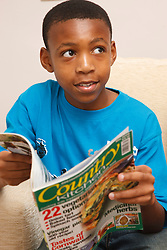 Teenager reading a magazine