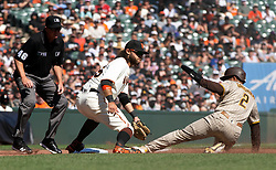 Oct 3, 2021; San Francisco, California, USA; San Diego Padres center fielder Trent Grisham (2) slides safely into third base ahead of the tag of San Francisco Giants shortstop Brandon Crawford (35) on a groundout by Fernando Tatis Jr. during the fourth inning at Oracle Park. Umpire is Ron Kulpa. Mandatory Credit: D. Ross Cameron-USA TODAY Sports