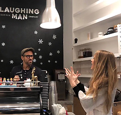 """Hugh Jackman releases a photo on Twitter with the following caption: """"""""Our policy at @laughingmanco is to make people happy - not drive them insane. Exhibit A = @VancityReynolds. @blakelively your coffee is on the house ... forever."""""""". Photo Credit: Twitter *** No USA Distribution *** For Editorial Use Only *** Not to be Published in Books or Photo Books ***  Please note: Fees charged by the agency are for the agency's services only, and do not, nor are they intended to, convey to the user any ownership of Copyright or License in the material. The agency does not claim any ownership including but not limited to Copyright or License in the attached material. By publishing this material you expressly agree to indemnify and to hold the agency and its directors, shareholders and employees harmless from any loss, claims, damages, demands, expenses (including legal fees), or any causes of action or allegation against the agency arising out of or connected in any way with publication of the material."""