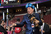 Comedian Stephen Colbert, host of Late Night holds a stuffed weasel dressed in costume during the filming of a skit on the floor of the Democratic National Convention July 24, 2016 in Philadelphia, Pennsylvania. Colbert appeared dressed as Caesar Flickerman from the Hunger Games and continues the act from last weeks Republican Convention.