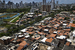 October 9, 2016 - Boa Viagem, Brazil - Despite much social inequality, the neighborhood of Boa Viagem is one of the most affluent neighborhoods and known from northeastern Brazil.  José Belmiro dos Santos is 84 years old, married to Rosalia Maria da Conceição and has nine children. He is retired since 1997 and works in a parking taking care of vehicles. The parking lot is situated in an abandoned building in Boa Viagem, in Recife, Pernambuco state, Brazil.Mr. José has to live in the building and can only visit family once a month. He thinks it's dangerous, because the parking lot is located inside a slum, but need to earn cash and stay home another person can take his job.Mr. José is part of a national statistic that indicates an increase in the number of pensioners who return to work in Brazil, 5.9% in the first quarter of 2012 to 6.5% in the second quarter 2016 (data from the Brazilian Institute of geography and Statistics), due to the current economic crisis.The government of the current President Michel Temer has as one of the goals the approval of Welfare Reform, thus ensuring clearer rules for retirement and the increase in the contribution to the public coffers. The approval of new rules for retirement might take the Brazil of the crisis and increase a government approval rating scored by polemics and an impeachment questioned by the opposition. (Credit Image: © Diego Herculano/NurPhoto via ZUMA Press)