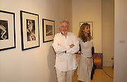 Maryam D'Abo and Hugh Hudson, photo-london at the Royal Academy, 19 May 2004. ONE TIME USE ONLY - DO NOT ARCHIVE  © Copyright Photograph by Dafydd Jones 66 Stockwell Park Rd. London SW9 0DA Tel 020 7733 0108 www.dafjones.com
