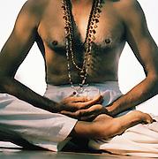Yoga expert in lotus position, Kerala, India