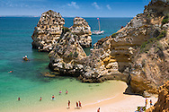 Lagos, Algarve, Portugal, June 2014. Ponta da Piedade.  A spectacular coastline of steep sandstone cliffs borders hidden sandy beaches on the south western tip of Europe, where the Mediterranean becomes the Atlantic Ocean.  Photo by Frits Meyst / MeystPhoto.com
