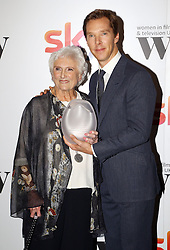 Benedict Cumberbatch presented Beryl Vertue with the EON Productions lifetime achievement award at the Women in Film & TV Awards at the Hilton hotel in central London.
