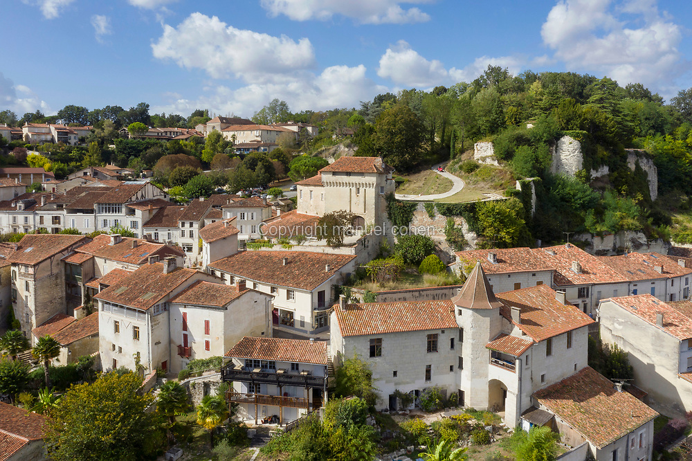Village of Aubeterre-sur-Dronne, aerial view, in Charente, Nouvelle-Aquitaine, France. In the centre is the Chateau d'Aubeterre, built in the 11th century. The village has existed since the Middle Ages and is on the pilgrimage route to Santiago de Compostela in Spain. It is famous for its monolithic underground Eglise Saint Jean and its Romanesque Eglise Saint Jacques. It is listed as one of 'Les Plus Beaux Villages de France'. Picture by Manuel Cohen