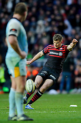 Saracens replacement (#22) Owen Farrell kicks a Penalty as Northampton Hooker (#2) Dylan Hartley (Capt) looks on during the second half of the match - Photo mandatory by-line: Rogan Thomson/JMP - Tel: Mobile: 07966 386802 30/12/2012 - SPORT - RUGBY - stadiummk - Milton Keynes. Saracens v Northampton Saints - Aviva Premiership.