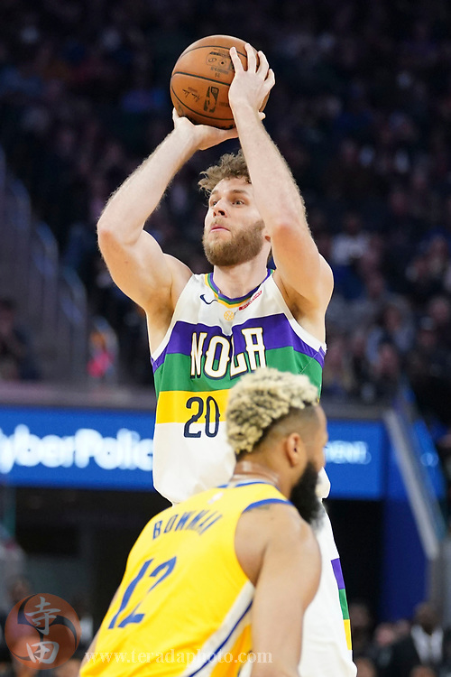 February 23, 2020; San Francisco, California, USA; New Orleans Pelicans forward Nicolo Melli (20) shoots the basketball against Golden State Warriors guard Ky Bowman (12) during the third quarter at Chase Center.