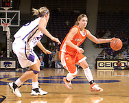 Idaho State guard Joanna Hixon (R) drives up court against pressure from Kansas State's Danielle Zanotti (L) during the first half at Bramlage Coliseum in Manhattan, Kansas, March 17, 2006.  K-State defeated the Bengals 88-68 in the first round of the WNIT.