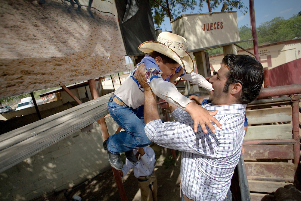 Julia Robinson photo.Charreada is a family tradition and a family event.  Young charros learn from older relatives and dream of the day when they too can join the team.