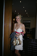 Laura Bailey. 4 Inches, A  Photographic Auction in aid of the Elton John Aids Foundation hosted by Tamara Mellon and Arnaud Bamberger. Christie's. 8 King St. London. 25 May 2005. ONE TIME USE ONLY - DO NOT ARCHIVE  © Copyright Photograph by Dafydd Jones 66 Stockwell Park Rd. London SW9 0DA Tel 020 7733 0108 www.dafjones.com