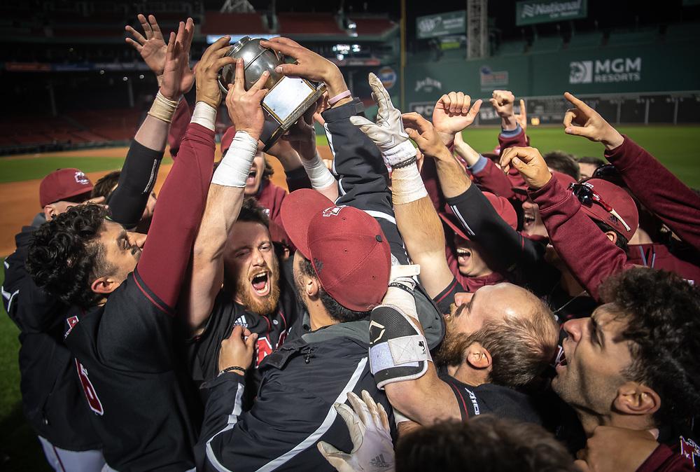 The UMass Amherst men's baseball team celebrates winning the Baseball Beanpot championship game against Harvard University at Fenway Park in Boston, Massachusetts on Wednesday, April 17 2019.