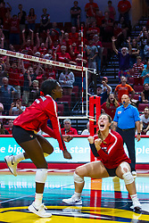 BLOOMINGTON, IL - September 14: Emmy Ogogor and Monica Miller celebrate during a college Women's volleyball match between the ISU Redbirds and the University of Central Florida (UCF) Knights on September 14 2019 at Illinois State University in Normal, IL. (Photo by Alan Look) Official in stand is Marek Fracz