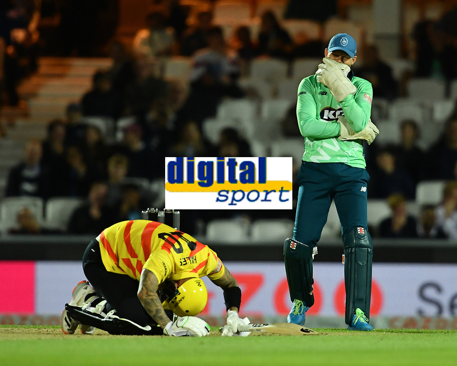 iCricket - 2021 - The Hundred - Men's Competitions - Oval Invincibles vs Trent Rockets - Kia Oval - Sunday 8th August 2021<br /> <br /> Trent Rockets' Alex Hales gets hit which amuses Oval Invincibles' Sam Curran.<br /> <br /> COLORSPORT/Ashley Western