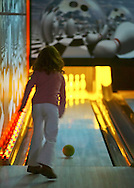 A girl uses a mini bowling lane at Lucky Strike Lanes at the Palisades Center mall in West Nyack on Jan. 12, 2007.