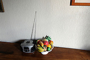 still life with small radio and fake plastic fruit