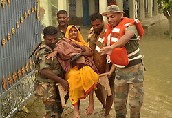 August 21, 2017 - Madhubani, Bihar, India - Army personnel help evacuate an elderly person and distribute food to people trapped in the flooded area of the Madhubani district of Bihar. (Credit Image: © Prabhat Kumar Verma via ZUMA Wire)