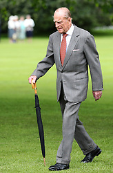 The Duke of Edinburgh arrives for the Presentation Reception for The Duke of Edinburgh Gold Award holders in the gardens at the Palace of Holyroodhouse in Edinburgh.