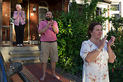 As the number of UK deaths from Coronavirus reaches 37,837, a further 377 in the last 24hrs a family stand outside their house to clap for the NHS National Health Service key worker heroes for the last time during the UK Coronavirus pandemic lockdown, on 28th May 2020 in London, England.