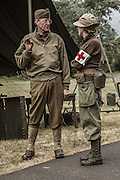 USA, Oregon, Astoria, Ft. Stevens State Park, living historian medical personnel discussing something.